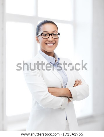 business and education concept - african businesswoman in office - stock photo