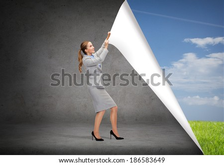 business and education concept - smiling businesswoman changing sceneries - stock photo