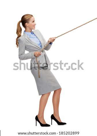 business and education concept - smiling businesswoman pulling rope - stock photo