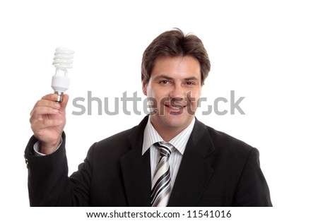 Business and Environment.  Businessman holding up an eco energy efficient light globe.
