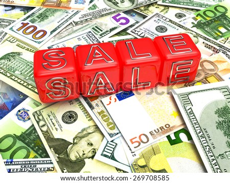 """Business and financial concept. Red cubes with the word """"Sale"""" on a pile of different money bills - stock photo"""