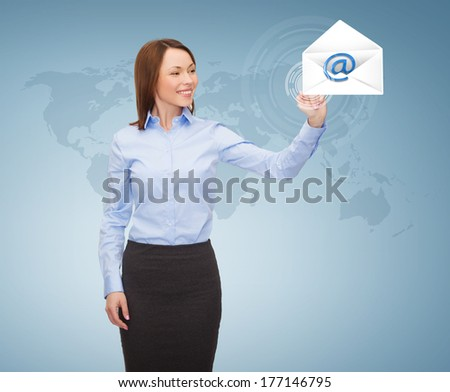 business and future technology concept - young businesswoman working with virtual screen - stock photo