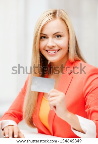 business and internet concept - smiling businesswoman with laptop using credit card - stock photo