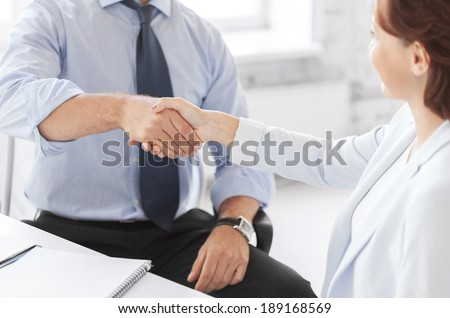 business and office concept - business people shaking hands in office