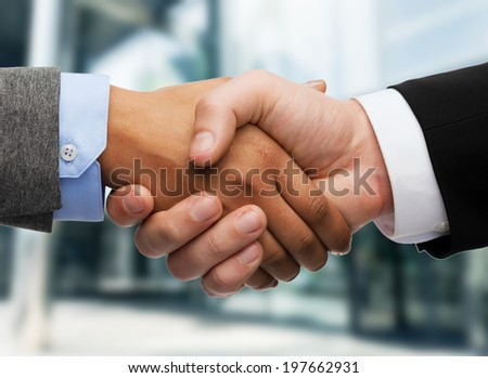 business and office concept - businessman and businesswoman shaking hands outdoors - stock photo