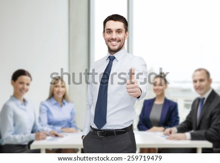 business and office concept - handsome businessman showing thumbs up - stock photo