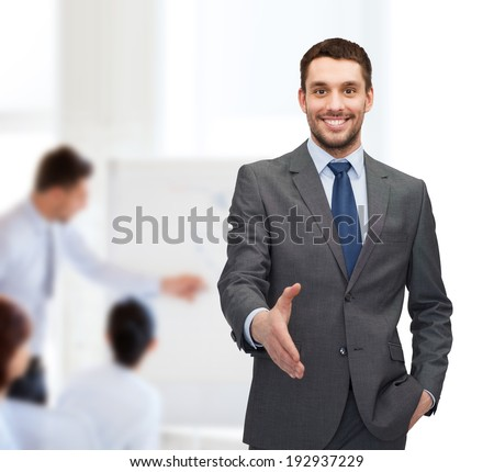 business and office concept - handsome businessman with open hand ready for handshake - stock photo