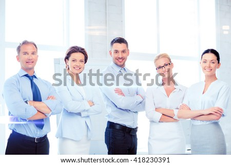 business and office concept - picture of friendly business team in office - stock photo