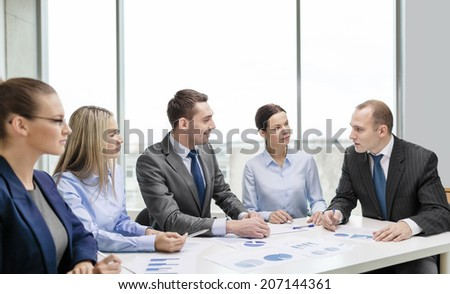business and office concept - smiling business team at meeting