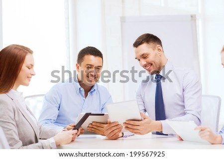 business and office concept - smiling business team working with tablet pc computers in office