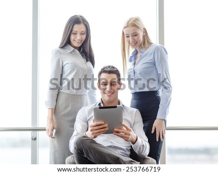 business and office concept - smiling business team working with tablet pc in office - stock photo