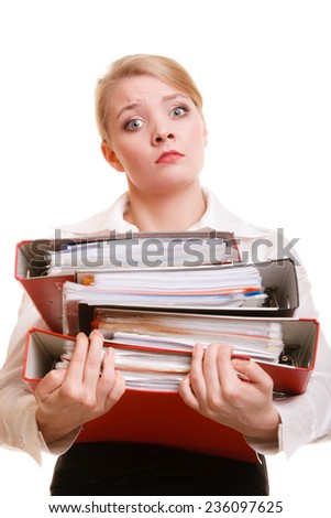 Business and paperwork. Young overworked businesswoman holding stack of folders documents. Busy woman working in office. - stock photo