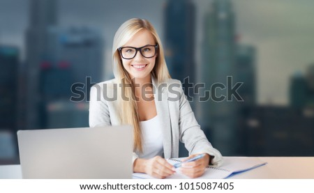 business and people concept - smiling businesswoman with notepad and laptop at office over singapore city skyscrapers background