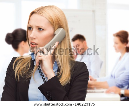 business and problems concept - confused woman arguing on the phone phone - stock photo