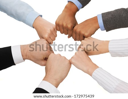 business and teamwork concept - closeup of businesspeople hands in fists in circle