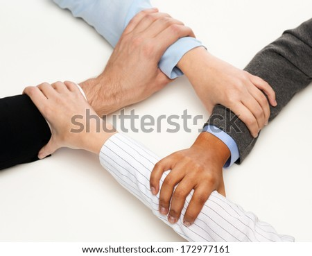 business and teamwork concept - closeup of businesspeople hands united