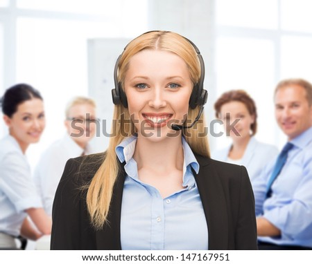 business and technology concept - helpline operator with headphones in call centre - stock photo