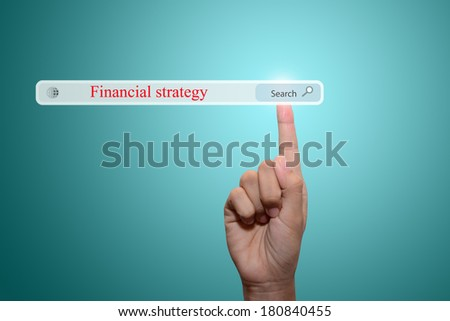 Business and technology, searching system and internet concept - male hand pressing Search Financial strategy button.  - stock photo