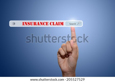 Business and technology, searching system and internet concept - male hand pressing Search INSURANCE CLAIM - stock photo