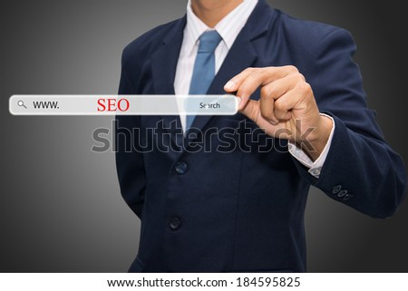 Business and technology, searching system and internet concept - male hand pressing Search SEO button.  - stock photo