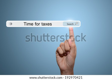 Business and technology, searching system and internet concept - male hand pressing Search time for taxes button.  - stock photo