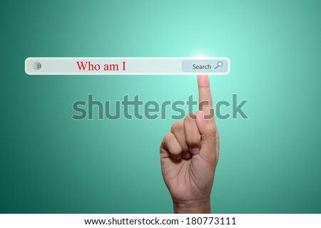 Business and technology, searching system and internet concept - male hand pressing Search Who am I button.  - stock photo