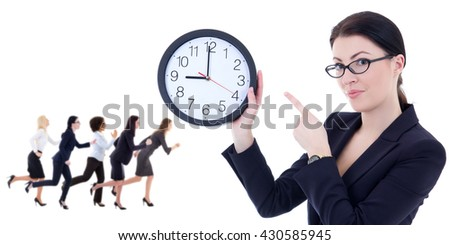 business and time concept - young woman holding office clock and her running colleagues isolated on white background - stock photo