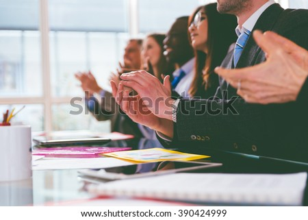 business applause. group of businessmen clapping hands during a business convention - stock photo
