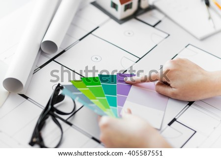 business, architecture, building, construction and people concept - close up of designer hands with color palette and blueprint - stock photo