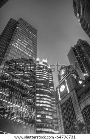 Business architecture, buildings, skyscrapers at night in black and white. - stock photo