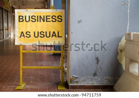 business as usual - sign - stock photo