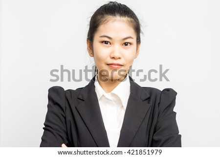 Business asian woman portrait in black suit on white background - stock photo