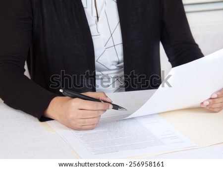 Business at workplace reading documents - stock photo