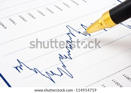 Business background, financial chart with ballpoint pen