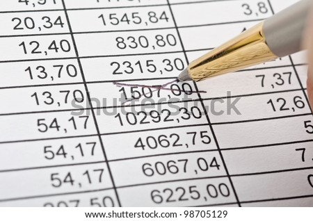 Business background, financial data concept with numbers and hand with pen - stock photo