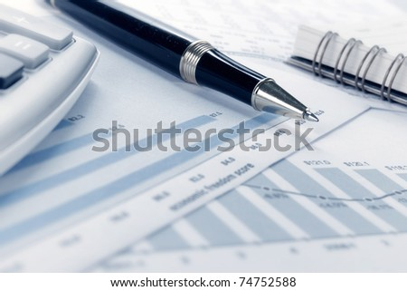 Business background, financial data concept with pen