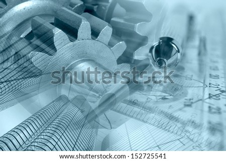 Business background in blues with pen, gear and buildings. - stock photo