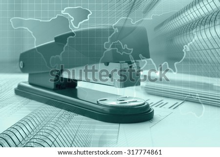 Business background in greens with graph, buildings, pen and stapler. - stock photo