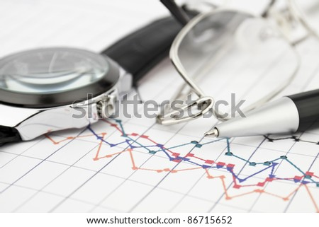 Business background with glasses pen and watch