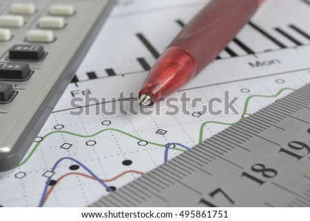 Business background with graph, pen, ruler and calculator.