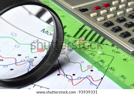 Business background with graph, ruler, pen, confetti and calculator. - stock photo