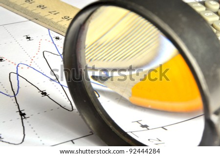 Business background with graph, ruler, pencil and magnifier. - stock photo
