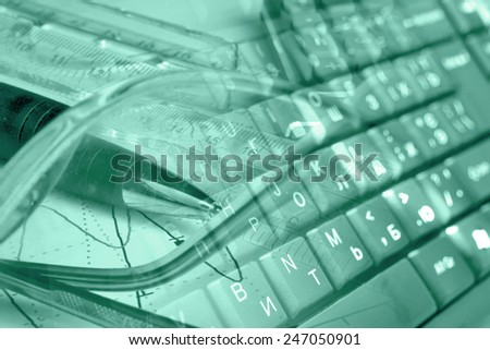 Business background with keyboard, glasses and pen, green toned. - stock photo