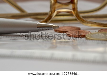 Business background with money, glasses and pen.