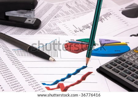 Business background with pen and calculations - stock photo