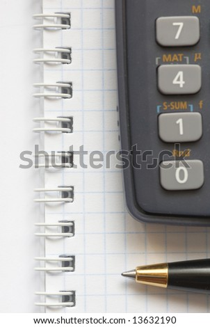 Business background with pen and calculator
