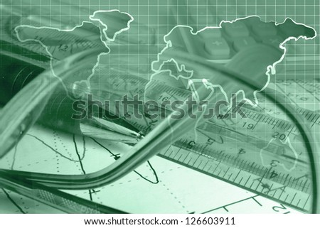Business background with pen, ruler and glasses, in greens. - stock photo