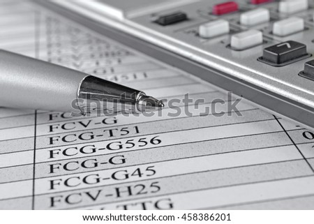 Business background with table, pen and calculator. - stock photo