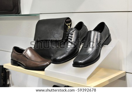 Business bag and back shoes on display. For concepts such as business and executive, and self grooming. - stock photo