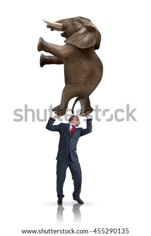 business balance challenge concept businessman holding weight of an elephant above his head - stock photo